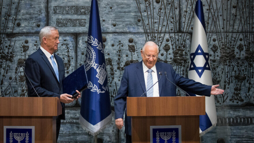 Israeli President Reuven Rivlin presents Blue and White Party leader Benny Gantz with the mandate to form a new Israeli government, at the President's Residence in Jerusalem on Oct. 23, 2019. Photo by Yonatan Sindel/Flash90.