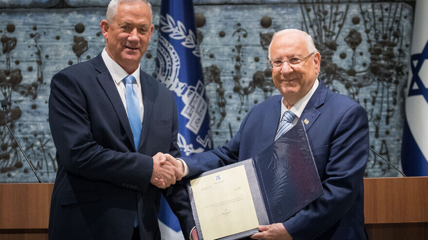 Israeli President Reuven Rivlin presents Blue and White Party leader Benny Gantz with the mandate to form a new Israeli government, after Prime Minister Benjamin Netanyahu's failure to form one, at the President's Residence in Jerusalem, Oct. 23, 2019. Photo by Yonatan Sindel/Flash90.