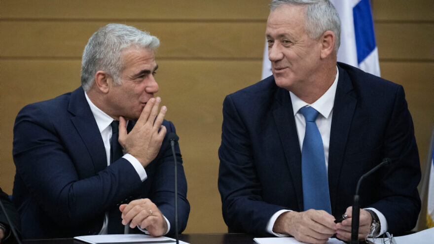 Blue and White Party leaders Benny Gantz (seated) and Yair Lapid at a faction meeting at the opening of the 22nd Knesset in Jerusalem, on Oct. 3, 2019. Photo by Hadas Parush/Flash90.