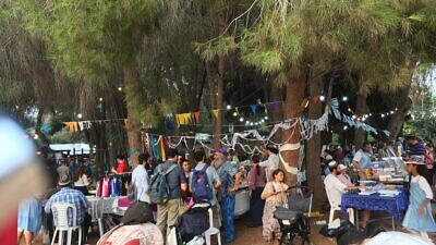 People taking part in the Moshav Fair during Sukkot in Moshav Mevo Modi'im, which was devstated by a wildfire in May 2019. Photo by: Deborah Fineblum.