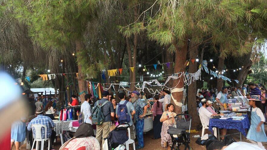People taking part in the Moshav Fair during Sukkot in Moshav Mevo Modi'im, which was devstated by a wildfire in May 2019. Photo by: Deborah Fineblum.