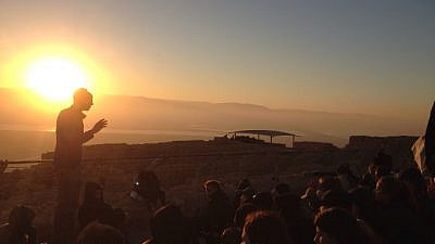 Students at the Alexander Muss High School Program in Israel learn about Jewish history atop Masada. Credit: AMHSI.