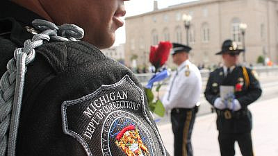 A Michigan Department of Corrections officer. Credit: Wikimedia Commons.