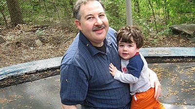 Leonard Posner with his son, Noah, who was killed in the Sandy Hook massacre in 2012. Source: Wikimedia Commons.
