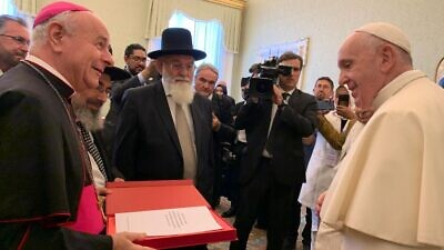 Rabbi Professor Avraham Steinberg at the presentation of a signed declaration to Pope Francis. Credit: Chief Rabbinate Spokesperson Kobi Alter.