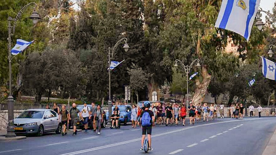 People walk along the empty road in Jerusalem on Yom Kippur, the Jewish Day of Atonement. While driving is prohibited, every year it seems that a few accidents occur, Oct. 9, 2019. Photo by Sara Klatt/Flash90.