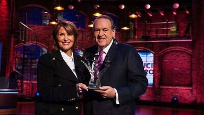 Laurie Cordoza-Moore, president of Proclaiming Justice to the Nations, with former Arkansas Gov. Mike Huckabee. Source: Facebook via PJTN.