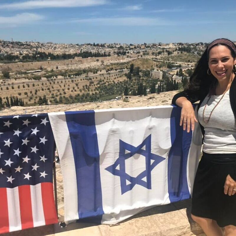 "Yael standing on the Mount of Olives overlooking the Old City of Jerusalem. As the new head of the International ""Fellowship"" that helps 1.5 million people a year, she has taken what her father, Rabbi Yechiel Eckstein, built and is adding her own vision to the 36-year-old organization. Source: Facebook."