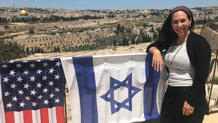 """Yael standing on the Mount of Olives overlooking the Old City of Jerusalem. As the new head of the International """"Fellowship"""" that helps 1.5 million people a year, she has taken what her father, Rabbi Yechiel Eckstein, built and is adding her own vision to the 36-year-old organization. Source: Facebook."""