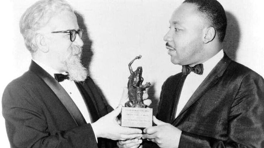 Rabbi Abraham Joshua Heschel with Rev. Martin Luther King Jr. Credit: Wikimedia Commons.