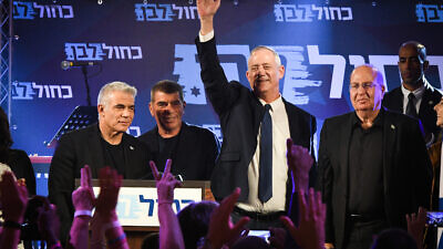 Blue and White head Benny Gantz (third from left) and fellow leaders (from left) Yair Lapid, Gaby Ashkenazi and Moshe Ya'alon with supporters at a party rally in Tel Aviv on Oct. 31, 2019. Photo by Avshalom Shoshoni/Flash90.