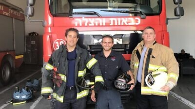 Emergency Volunteer Program Deployment Director Eitan Charnoff (center) and volunteer U.S. firefighters Spencer MacWilliams (left) and Jake Papageorgio at a fire station in Jerusalem, Israel. Photo: courtesy.