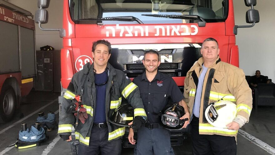 Emergency Volunteer Project Deployment director Eitan Charnoff (center) and volunteer U.S. firefighters Spencer MacWilliams (left) and Jake Papageorgio at a fire station in Jerusalem. Credit: Courtesy.