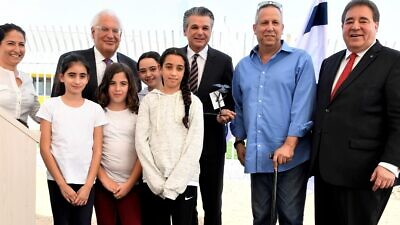 From left: Michal Uziyahu, Eshkol Region director of community centers, U.S. Ambassador to Israel David Friedman, Pastor Jentezen Franklin, Eshkol Mayor Gadi Yarkoni and JNF-USA CEO Russell Robinson join children in dedicating a new Playschool to relieve some of the stress and trauma experienced by living so close to voilence coming from the Gaza Strip, Nov. 6, 2019. Credit: JNF.