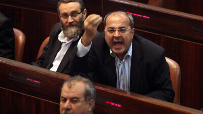 Knesset member Ahmad Tibi is seen calling out during a parliamentary session in the Knesset in Jerusalem on March 22, 2011. Photo by Abir Sultan/Flash90.