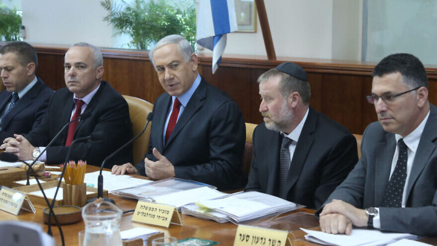 Israel's Prime Minister Benjamin Netanyahu  leads the weekly cabinet meeting, at his office in Jerusalem. June 08, 2014, flanked to his right by then-Cabinet Secretary and current Attorney General Avichai Mandelblit and Likud challenger Gideon Sa'ar. Photo by Marc Israel Sellem/POOL/FLASH90