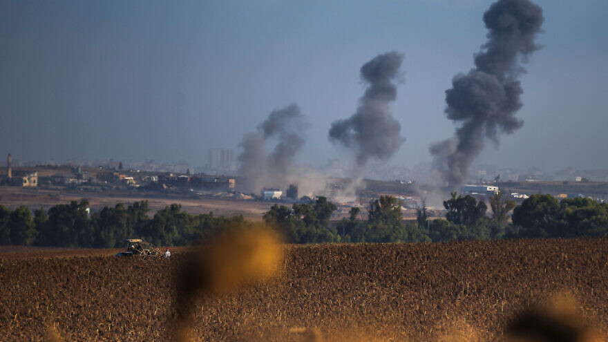 Smoke rises after an Israeli airstrike in the Gaza Strip on Aug. 3, 2014. Photo by Flash90.