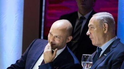 Former Education Minister Naftali Bennett (left) speaks with Israeli Prime Minister Benjamin Netanyahu during the Israel Prize award ceremony at the International Conference Center in Jerusalem on May 2, 2017. Photo by Yonatan Sindel/Flash90.