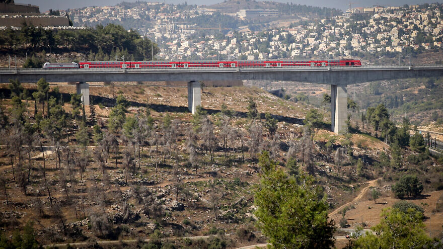 """A view of the new Tel Aviv-Jerusalem fast train, over the HaArazim Valley (""""Valley of Cedars"""") just outside of Jerusalem, Sept. 25, 2018. Photo by Yossi Zamir/Flash90."""