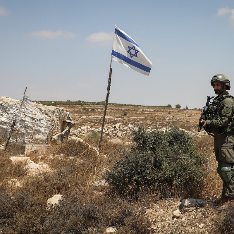An Israeli soldier stands guard at the site of a car ramming attack by a Palestinian terrorist in Elazar, in Gush Etzion, on August 18, 2019. Photo by Gershon Elinson/Flash90