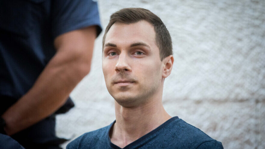 Aleksey Burkov, a Russian IT specialist and alleged hacker wanted by the United States, arrives for a court hearing at the Supreme Court in Jerusalem on Nov. 3, 2019. Photo by Yonatan Sindel/Flash90.