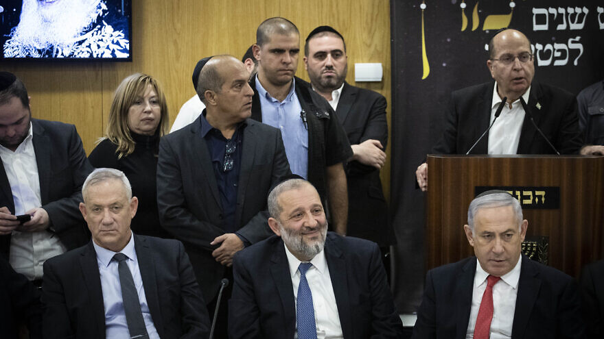 Shas Party chairman and Minister of Interior Affairs Aryeh Deri, Israeli Prime Minister Benjamin Netanyahu, and Blue and White Party leader Benny Gantz at a ceremony marking six years to the death of Rabbi Ovadia Yosef, the late religious spiritual leader of Israel's Sephardic Jews, at the Knesset the Israeli parliament in Jerusalem on Nov. 4, 2019. Photo by Hadas Parush/Flash90.