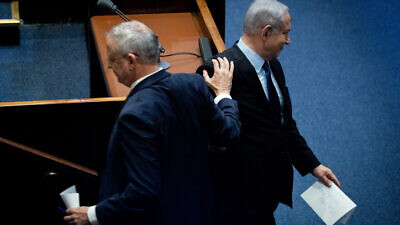 Israeli Prime Minister Benjamin Netanyahu and Blue and White Party leader Benny Gantz at a memorial ceremony in the Knesset marking 24 years since the assassination of former Israeli Prime Minister Yitzhak Rabin, on Nov. 10, 2019. Photo by Yonatan Sindel/Flash90.
