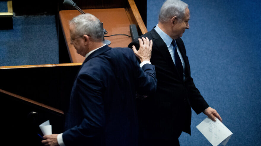 Blue and White Party leader Benny Gantz passes Israeli Prime Minister Benjamin Netanyahu at a memorial ceremony in the Knesset marking 24 years since the assassination of former Israeli Prime Minister Yitzhak Rabin, on Nov. 10, 2019. Photo by Yonatan Sindel/Flash90.
