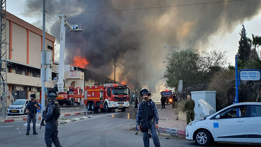 Israeli firefighters work to extinguish flames at a factory in Sderot ignited by a rocket launched by the Palestinian Islamic Jihad terror group over the Gaza border into Israel on Nov. 12, 2019. Photo by Flash90.
