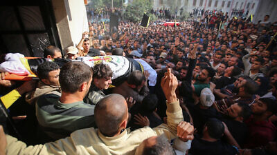 Mourners carry the body of Palestinian Islamic Jihad terrorist field commander Baha Abu Al-Atta during his funeral in Gaza City, after he was killed by an Israeli strike in a targeted attack on Nov. 12, 2019. Photo by Hassan Jedi/Flash90.