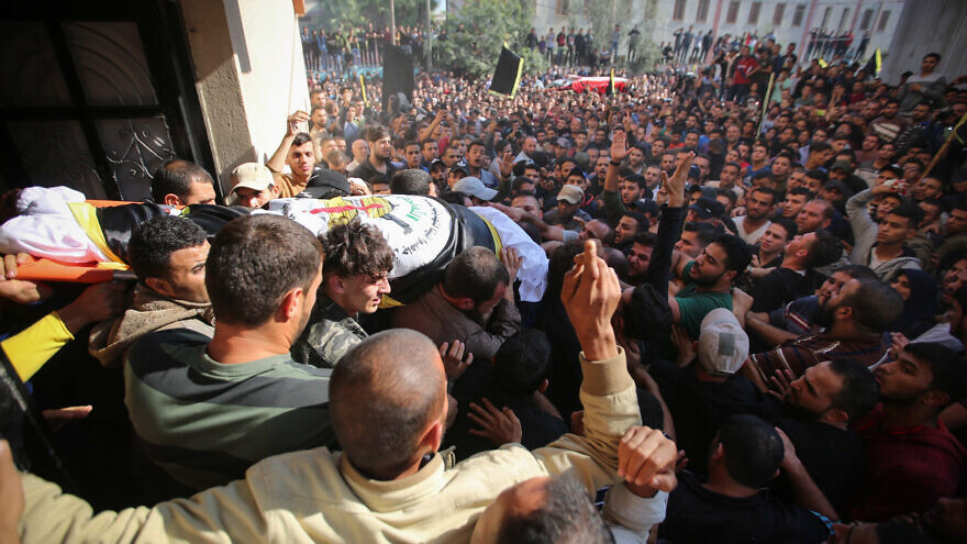 Mourners carry the body of Palestinian Islamic Jihad terrorist field commander Baha Abu al-Ata during his funeral in Gaza City after he was killed by an Israeli airstrike in a targeted attack on Nov. 12, 2019. Photo by Hassan Jedi/Flash90.