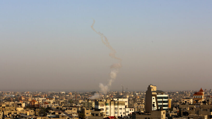 Smoke rises after rockets are fired towards Israel from Rafah in the southern Gaza Strip on Nov. 13, 2019. Photo by Abed Rahim Khatib/Flash90.