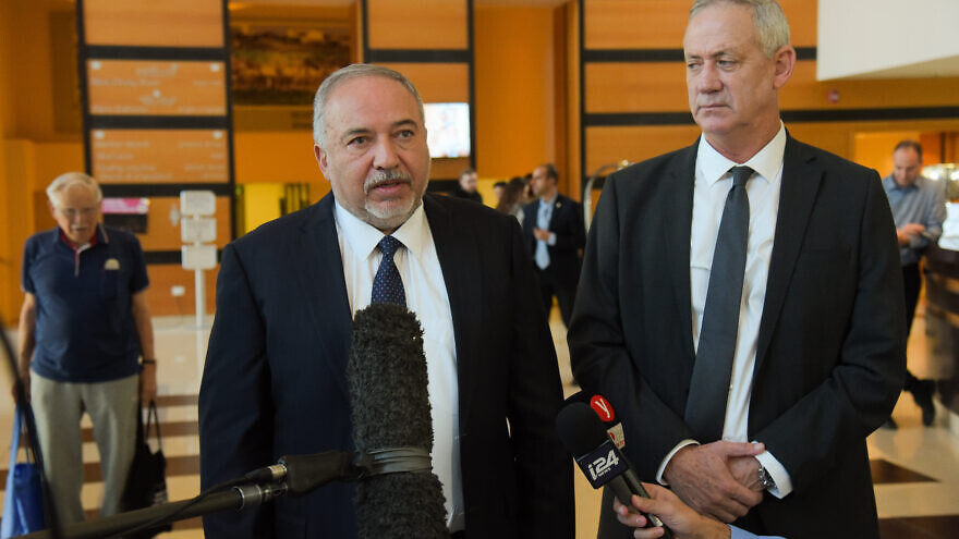 Blue and White Party chairman Benny Gantz and Israel Beitenu Party chairman Avigdor Lieberman give a joint statement to the media after a meeting for negotiations towards building a new government, at the Kfar Maccabia Hotel in Ramat Gan, on Nov. 14, 2019. Photo by Avshalom Sassoni/Flash90.