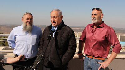 Israeli Prime Minister Benjamin Netanyahu, Gush Etzion Regional Council chairman Shlomo Ne'eman and Jordan Valley Regional Council chairman David Elchiani visit Alon Shvut in Gush Etzion on Nov. 19, 2019. Photo by Gershon Elinson/Flash90.