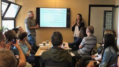 ADMA co-founders Amos Darr (left) and right Moran Amikam presenting at the open house at the ADMA Architecture Studio in the Clal Center in Jerusalem on Nov. 1, 2019. Credit: ADMA.