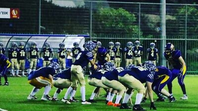 """Israeli children participate in a American Football game as part of the """"Young Champions"""" program founded by Erez Lustig, an Israeli nonprofit that today brings together 200 girls and boys, ages 6 to 16, on four teams that practice after school. Credit: Courtesy."""