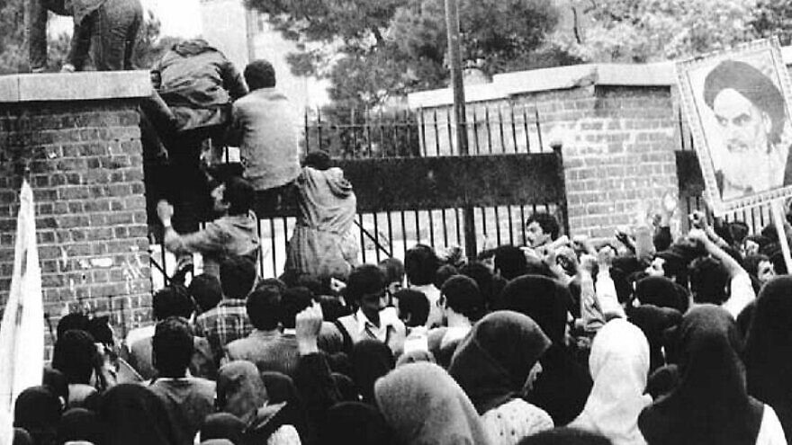 Iranian students breach the fence of the U.S. embassy in Tehran on Nov. 4, 1979. Credit: Wikimedia Commons.