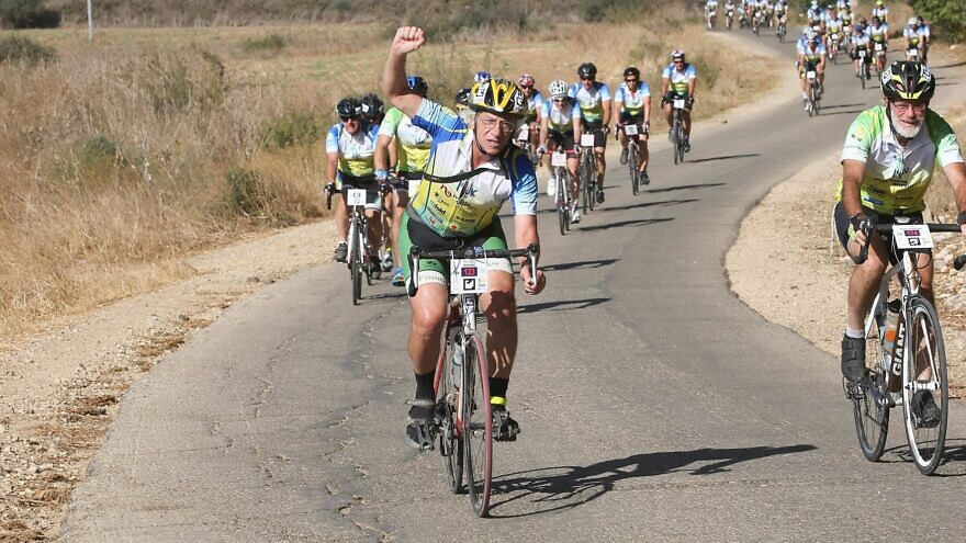 "Participants in the ""Wheels of Love"" charity ride in Israel. Photo by Tomer Feder."
