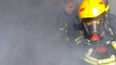 Twenty or so Israeli and Palestinian firefighters took part in a joint fire-fighting exercise at an Israeli academy in Rishon Letzion. Source: Facebook via COGAT.