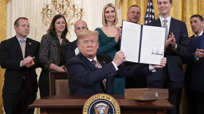 U.S. President Donald Trump displays his signature on an Executive Order committing his administration to combating the rise of anti-Semitism during an afternoon Hanukkah reception in the East Room of the White House on Dec. 11, 2019. Credit: Official White House Photo by Joyce N. Boghosian.
