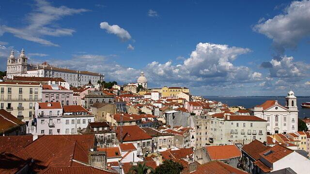 The Alfama quarter of Lisbon, Portugal, on April 24, 2011. Photo: Aubry Françon via Wikimedia Commons.