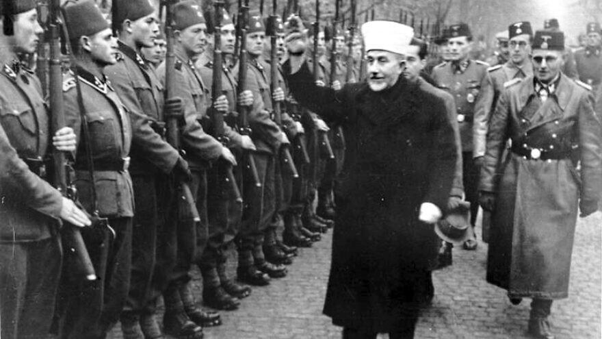 The Grand Mufti of Jerusalem Amin al-Husseini salute the Bosnian Waffen SS in November 1943. Credit: Bundesarchiv via Wikimedia Commons.
