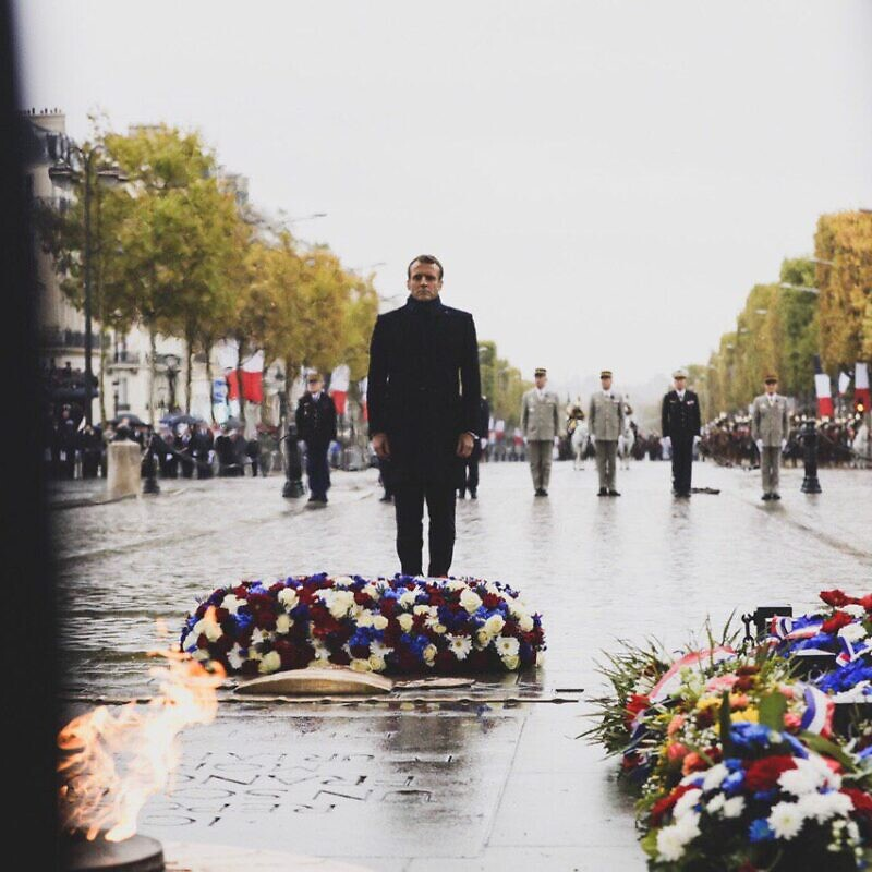 French President Emmanuel Macron paying his respect to fallen French soldiers from World War I. Source: Emmanuel Macron via Twitter.