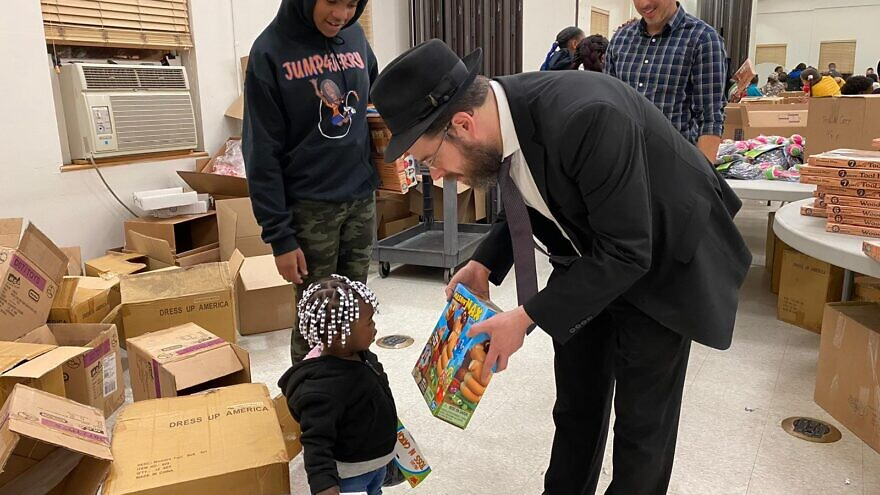 Black and Jewish volunteers in the Jersey City neighborhood of Greenville on Monday partnered up on a charity drive to deliver food and other goods to hundreds of local families in need. Source: Chesky Deutsch via Twitter.