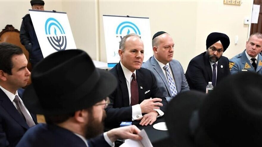 Among those who joined a community forum in Jersey City were, from left, Rabbi Moshe Schapiro, co-director of Chabad of Hoboken and Jersey City; Jersey City Mayor Steven Fulop; Elan Carr, the Trump administration's Special Envoy for Monitoring and Combating Anti-Semitism; Jason Shames, CEO and executive vice president of the Jewish Federation of Northern New Jersey; New Jersey Attorney General Gurbir Grewal; and New Jersey State Police Superintendent Col. Patrick Callahan. (Photo: New Jersey OAG)