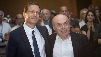 Incoming Jewish Agency chairman Isaac Herzog with outgoing chairman Natan Sharansky at the board of governors conference of the Jewish Agency at the Orient Hotel in Jerusalem on June 24, 2018. Photo by Hadas Parush/Flash90.