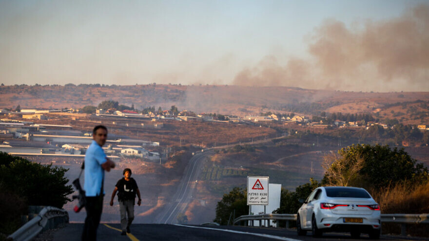 Smoke rises from a fire caused by a rocket fired from Lebanon at an Israeli military vehicle near Moshav Avivim in northern Israel, Sept. 1, 2019. Photo by David Cohen/Flash90.