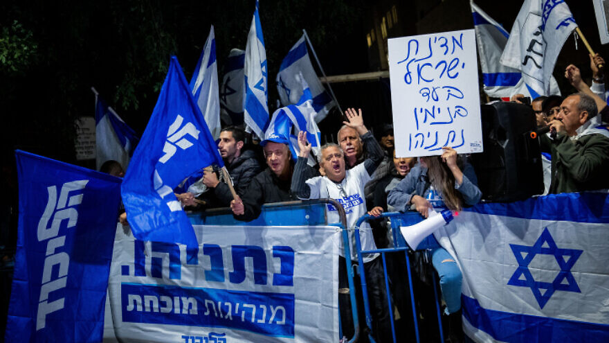 Supporters of Israeli Prime Minister Benjamin Netanyahu show their support outside the Prime Minister's Residence in Jerusalem on Nov. 30, 2019, following the announcement by Attorney General Avichai Mandelblit that Netanyahu will stand trial for bribery, fraud and breach of trust. Photo by Yonatan Sindel/Flash90.