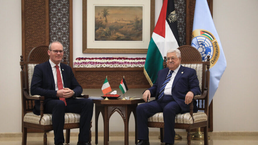 Palestinian Authority leader Mahmoud Abbas meets with Irish Foreign Minister Simon Coveney (left) at P.A. headquarters in Ramallah, on Dec. 3, 2019. Photo by Flash90.