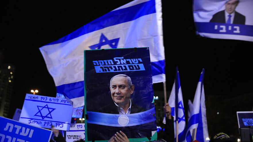 Supporters of Israeli Prime Minister Benjamin Netanyahu show their support near the Supreme Court in Jerusalem, Dec. 11, 2019. Photo by Olivier Fitoussi/Flash90.